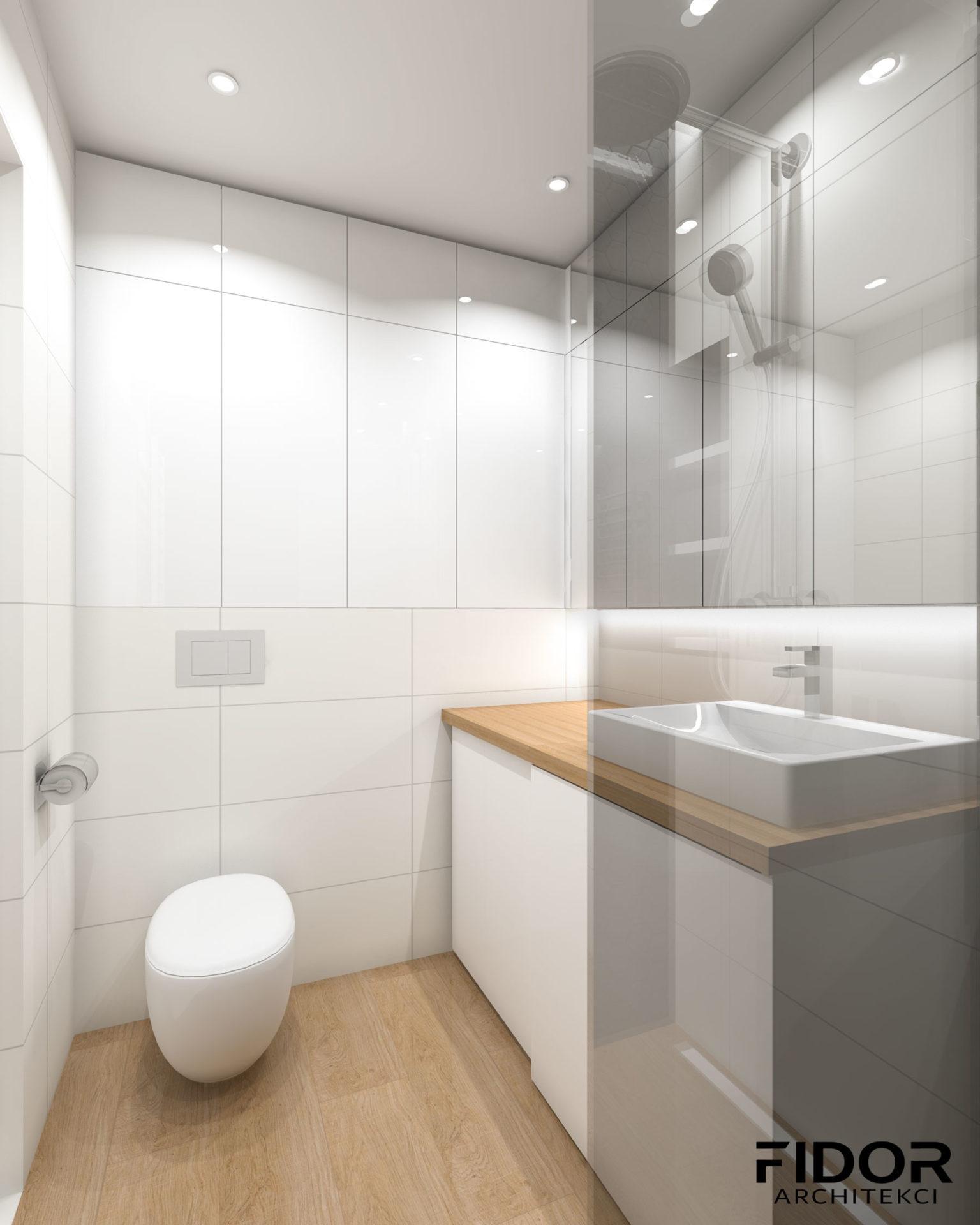 Łazienka w nowoczesnym mieszkaniu, widok na toaletę.