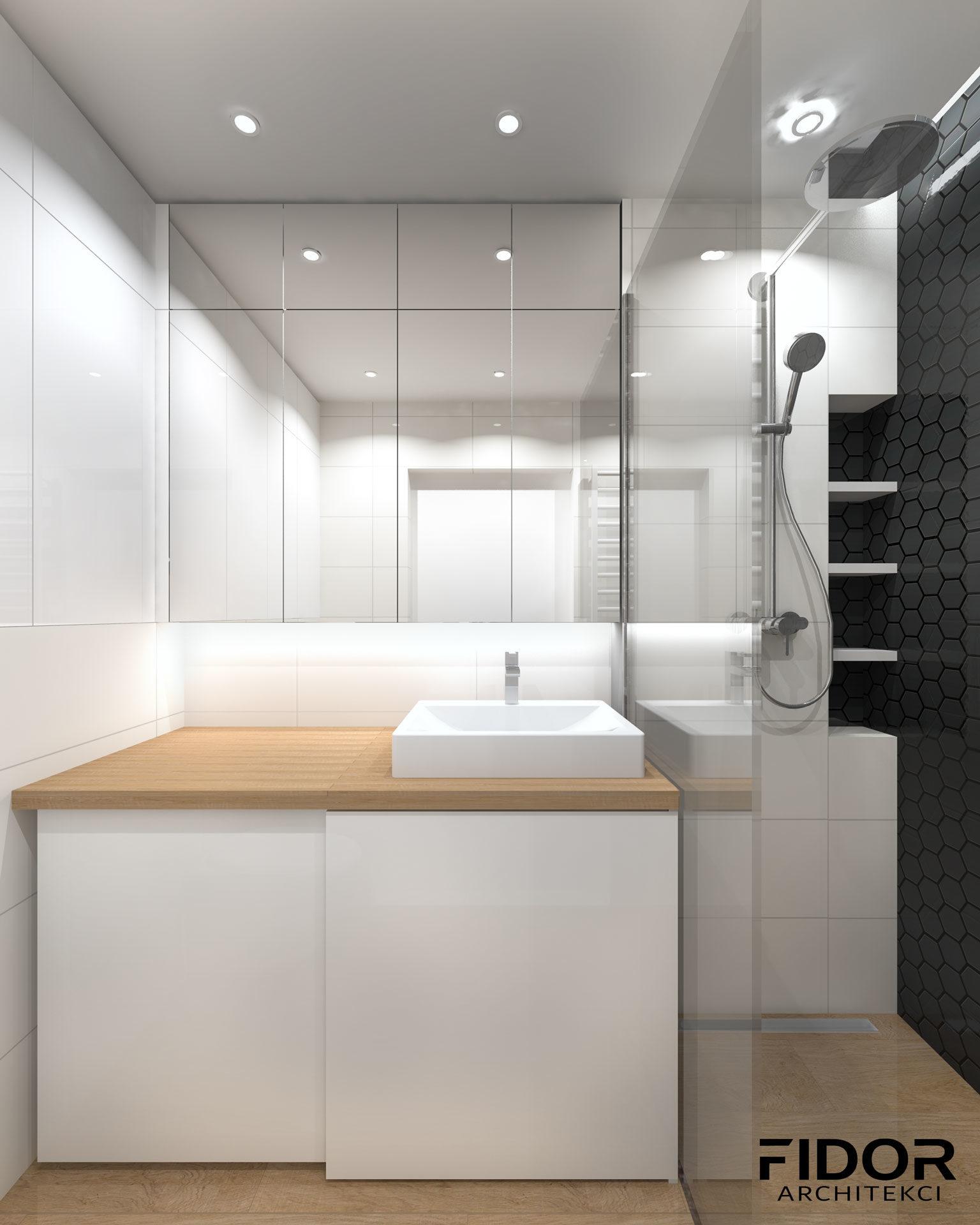 Łazienka w nowoczesnym mieszkaniu, widok na umywalkę.