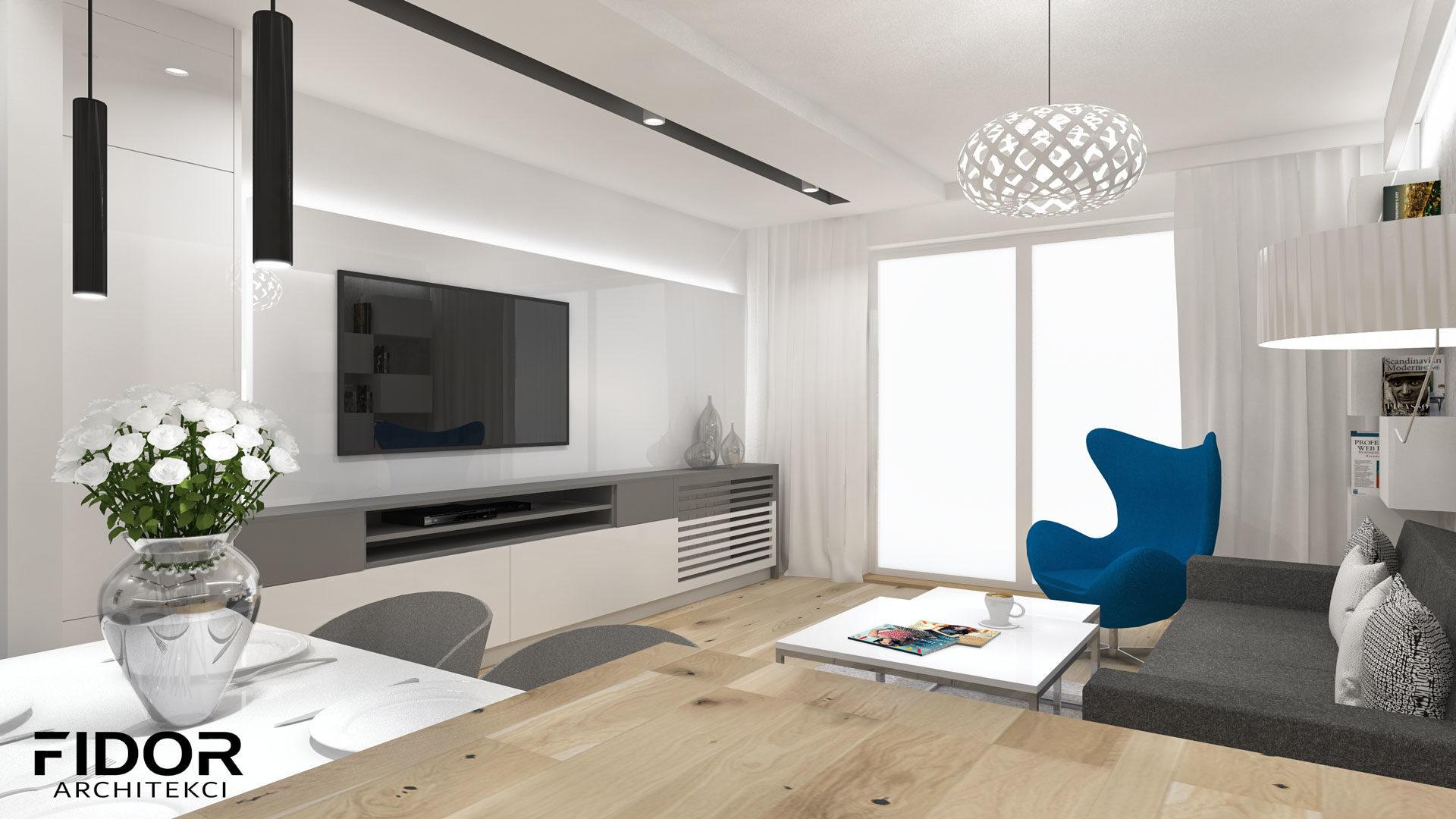 Salon w nowoczesnym mieszkaniu, widok na ścianę z telewizorem.